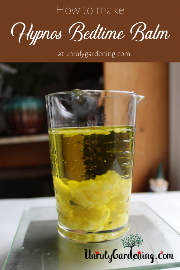 A pinterest pin of a jar of oil, beeswax floating within, standing on the top of an electronic scale.