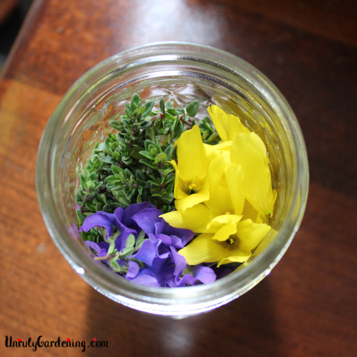 Jar of herbs and flowers.