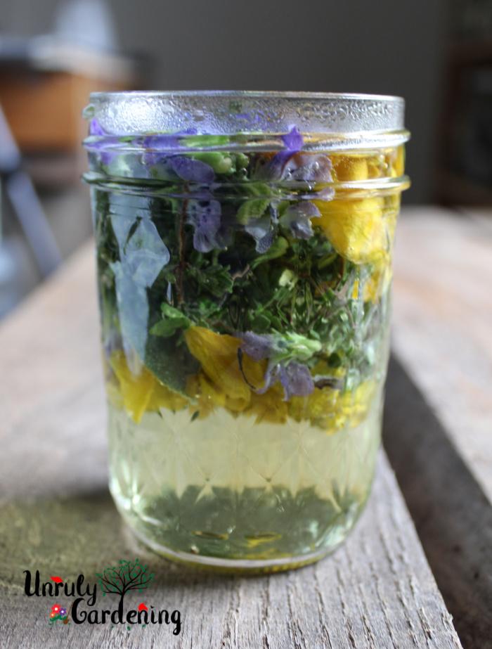 Jar of steeping herbs and flowers.