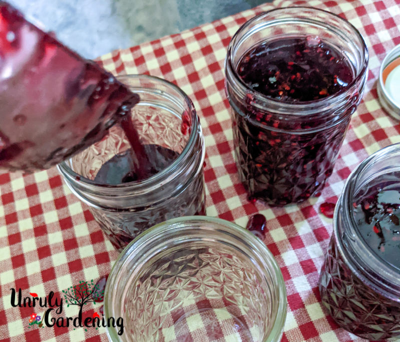 jars being filled with hot jam